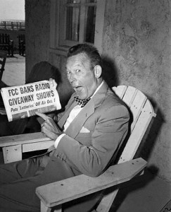 Fred Allen Holding a Newspaper